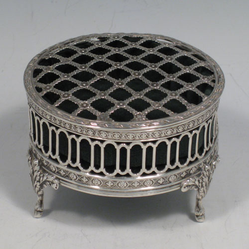 Antique Edwardian sterling silver pot-pourri holder. Having a round hand-pierced lid and body, sitting on three cast foliate feet. Made by William Comyns of London in 1907. Diameter 8 cms (3.25 inches), height 6 cms (2.25 inches).