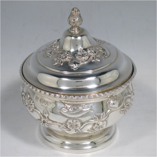 An Antique Edwardian Sterling Silver pot pourri holder, having a round bellied hand-body body with bird and floral decoration, a hinged lid with cast floral finial, and an internal pull-off pierced grill with ball finial, all sitting on a pedestal foot. Made by Nathan & Hayes of Chester in 1909. The dimensions of this fine hand-made antique silver pot-pourri holder are diameter 9 cms (3.5 inches), height 11 cms (4.3 inches), and it weighs approx. 157g (6 troy ounces).