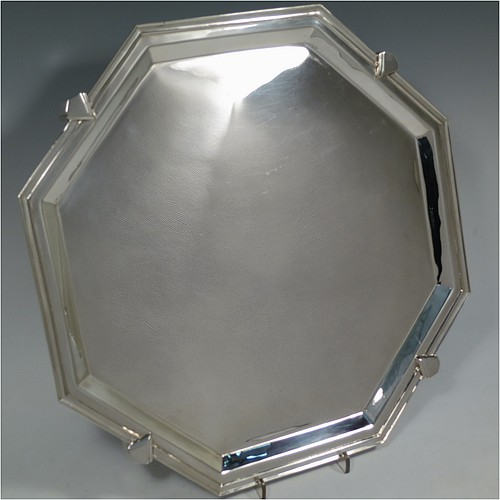 A very handsome and striking Art Deco Sterling Silver salver, having an octagonal body with an applied reeded border, with a plain burnished ground, and sitting on four cast panelled feet. Made by Charles William Fletcher of Sheffield in 1936. The dimensions of this fine hand-made Art Deco style silver salver are 34 cms (13.5 inches) diameter, and it weighs approx. 992g (32 troy ounces).