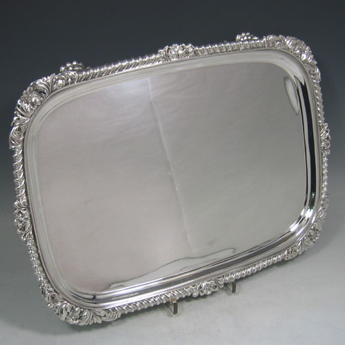 Antique Georgian sterling silver rectangular salver with gadroon & shell border made in London in 1825. Length 42 cms, width 31 cms.