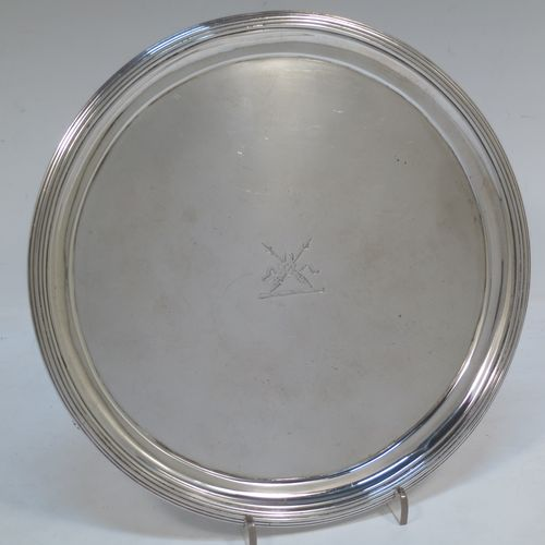A very handsome Antique Georgian Sterling Silver George IV salver, having a round body with plain burnished ground, an applied reeded border, and sitting on three cast flange feet. Made by Joseph Craddock and William Ker Reid of London in 1824. The dimensions of this fine hand-made antique silver salver are diameter 21.5 cms (8.5 inches), height 3 cms (1.25 inches), and it weighs approx. 397g (12.8 troy ounces). Please note that this item is crested.