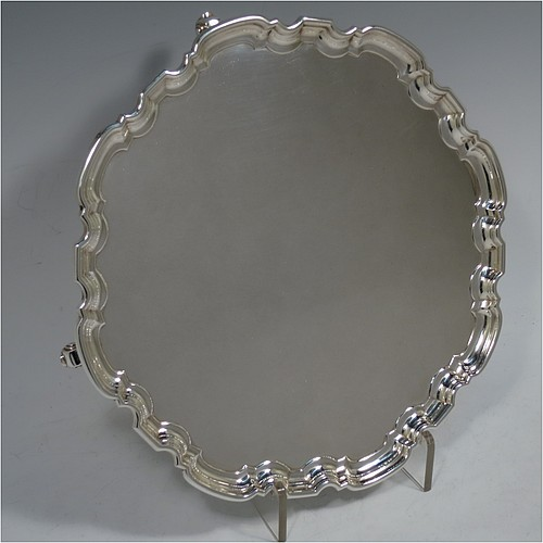A very handsome Scottish Sterling Silver salver, having a round body, with a plain burnished ground, an applied Chippendale border, and sitting on four cast scroll feet. Made by Davidson, Henderson, and Sorley of Glasgow in 1933. The dimensions of this fine hand-made Scottish silver salver are diameter 26 cms (10.25 inches), and it weighs approx. 618g (20 troy ounces).