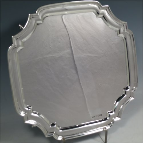 A Sterling Silver salver, having a square cut-corner body, with a plain burnished ground, an applied cut-corner border, and sitting on four cast scroll feet. Made by Emile Viner of Sheffield in 1938. The dimensions of this fine hand-made silver salver are 26.5 cms (10.5 inches) square, and it weighs approx. 547g (17.6 troy ounces).