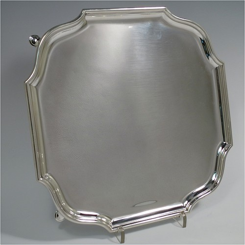 A Sterling Silver salver, having a square body with shaped and cut corners, a plain burnished ground, an applied reeded border, and sitting on four cast hoof feet. Made by Hawksworth Eyre and Co., of London in 1925. The dimensions of this fine hand-made silver salver are 26 cms (10.25 inches) square, and it weighs approx. 809g (26 troy ounces).