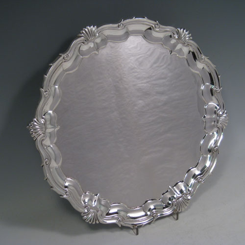 A very elegant Antique Victorian Sterling Silver salver, having an applied shell and scroll border, a plain ground, and sitting on three cast scroll feet. Made in London in 1840. The dimensions of this fine hand-made antique silver salver are diameter 29.5 cms (11.5 inches), height 3.5 cms (1.3 inches), and it weighs approx. 850g (27 troy ounces)