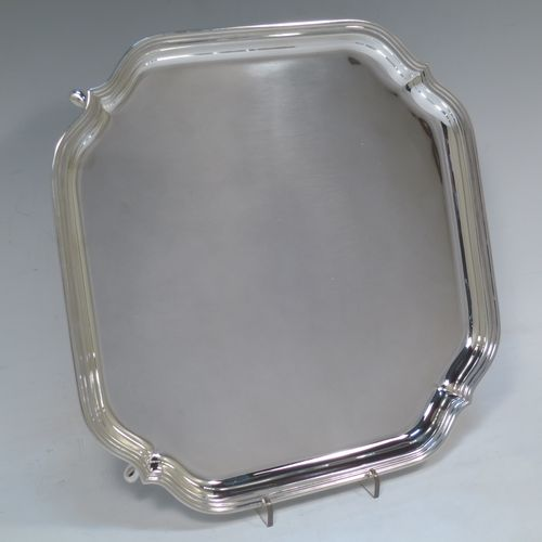 A very handsome Sterling Silver salver, having a square body with shaped and cut corners, a plain burnished ground, an applied reeded border, and sitting on four cast hoof feet. Made by Deakin Silversmiths of Sheffield in 1940. The dimensions of this fine hand-made silver salver are 26 cms (10.25 inches) square, and it weighs approx. 625g (20 troy ounces).