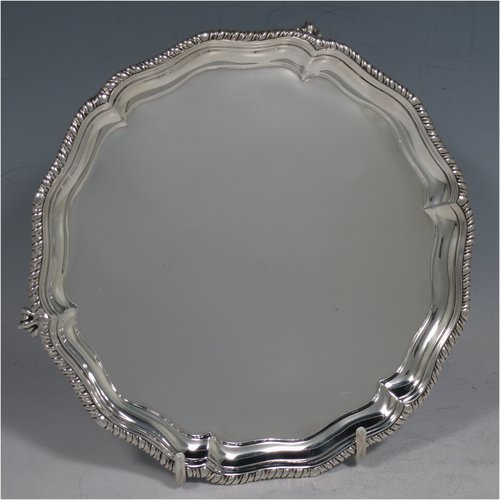 An Antique Victorian Sterling Silver salver, having a shaped gadroon border, a plain ground, and sitting on three claw and ball feet. Made by Charles Stuart Harris of London in 1888. The dimensions of this fine hand-made antique silver salver are diameter 18 cms (7 inches), and it weighs approx. 248g (8 troy ounces).