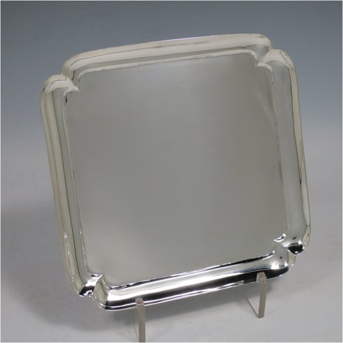 An Antique Victorian Sterling Silver salver in a George I square cut-corner style, having a plain ground, a shaped square border, and sitting on four cast flange feet. Made by Charles Boyton of London in 1890. The dimensions of this fine hand-made antique silver salver are 18 cms (7 inches) square, and a weight of approx. 298g (9.6 troy ounces).