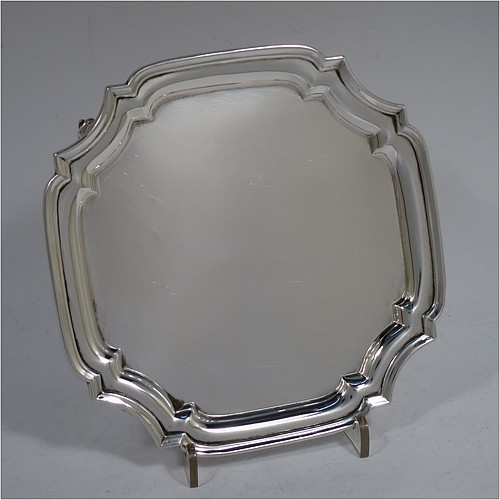 A very handsome Sterling Silver salver, having a square body with an applied cut-corner border, a plain ground, and sitting on four cast scroll feet. Made by S. Blanckensee and Sons of Chester in 1930. The dimensions of this fine hand-made silver salver are 15 cms (6 inches) square, and it weighs approx. 254g (8.2 troy ounces).