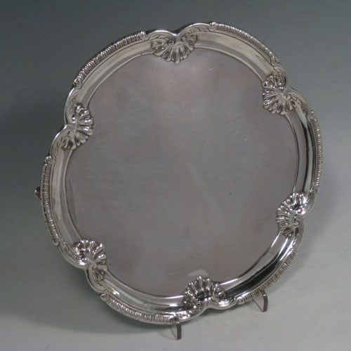 Antique Georgian George III salver, having a plain ground, cast applied gadroon and inverted shell border, and sitting on three cast hoof feet. Made by David Bell of London in 1761. The dimensions of this fine hand-made silver salver are diameter 20 cms (8 inches), and it weighs approx. 405g (13 troy ounces).