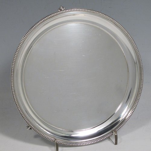 Sterling silver salver, having a plain ground, with an applied bead-edged border, and all sitting on three cast and claw and ball feet. Made in London in 1977 with Jubilee mark. The dimensions of this fine hand-made silver salver are diameter 15 cms (6 inches), and it weighs approx. 161g (5.2 troy ounces).