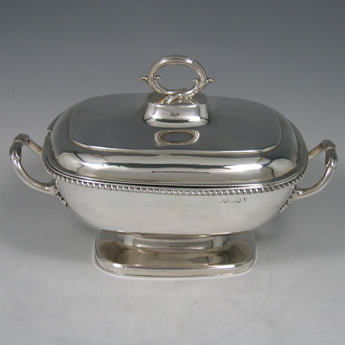 Antique Georgian sterling silver sauce tureen and cover, made by Robert Garrard I of London in 1807. Length 21 cms, height 14 cms.