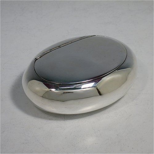 An Antique Victorian Sterling Silver tobacco box, having a plain oval body, and squeeze-action sprung hinged lid. Made by Elkington & Co., of Birmingham in 1901. The dimensions of this fine hand-made antique silver tobacco box are length 9 cms (3.5 inches), width 6.5 cms (2.5 inches), depth 3 cms (1.25 inches), and it weighs approx. 102g (3.3 troy ounces).