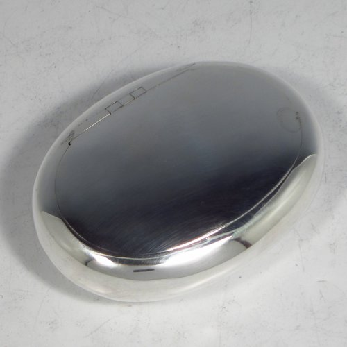 An Antique Victorian Sterling silver tobacco box, having a plain oval body, and squeeze-action sprung hinged lid. Made by Saunders & Shepherd of Birmingham in 1896. The dimensions of this fine hand-made silver tobacco box are length 8.5 cms (3.3 inches), depth 2.5 cms (1.0 inches), and it weighs approx. 75g (2.4 troy ounces).