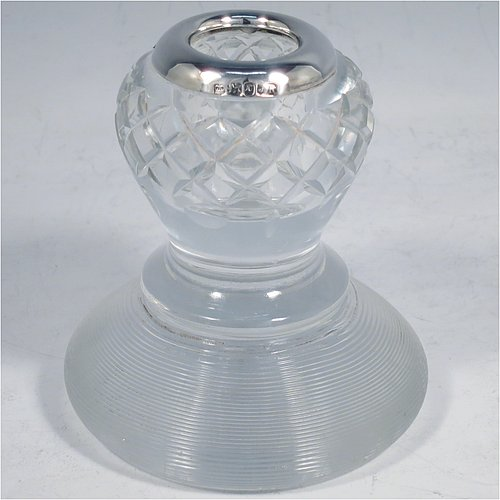An Antique Victorian Sterling Silver and crystal match holder and striker, having a a very unusual round baluster body, with a silver rim around the match holder, a hand-cut hobnail pattern upper body and a lower ridged body for striking the matches. Made by James Round of Sheffield in 1895. The dimensions of this fine hand-made antique silver and crystal match striker are diameter 8.5 cms (3.3 inches), and height 9.5 cms (3.75 inches).