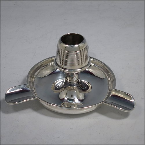 An Antique Edwardian Sterling Silver combination  match holder, striker, and ash-tray, having a plain round body, with three cigarette holders, and a central match holder with sloping striker sides, and all sitting on a flat base. Made by Charles Cooke of Chester in 1902. The dimensions of this fine hand-made antique silver match striker and ash-tray are diameter 7.5 cms (3 inches), height 6 cms (2.3 inches), and it weighs approx. 60g (2 troy ounces).