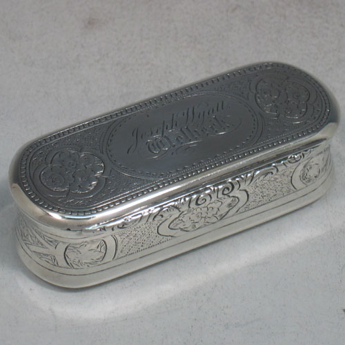 Antique Victorian sterling silver and gold-gilt snuff box made by George Unite of London in 1872. Originally presented to Joseph Wyatt, who we believe was the head groundsman of Wellbeck house. Hand engraved with floral work, and with three panels on base that have a thistle (for Scotland), a rose (for England), and a shamrock (for Ireland). Length 9 cms.