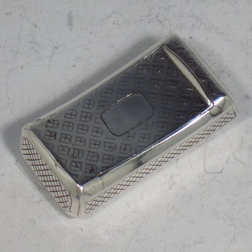 An Antique Georgian Sterling silver snuff box, having a rectangular body, with a slightly curved profile, with hand-engraved geometrical & floral decoration, a flat invisibly hinged lid with thumb-piece, and a gold-gilt interior. Made by Joseph Willmore of Birmingham in 1811. The dimensions of this fine hand-made antique silver snuff box are length 4.5 cms (1.75 inches), width 2.3 cms (0.8 inches), and it weighs approx. 17g (0.5 troy ounces).