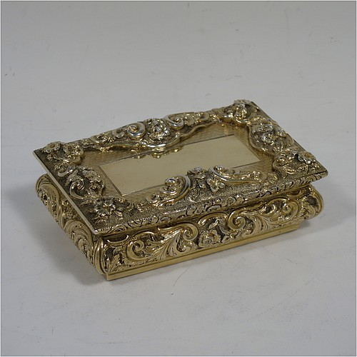A rare and beautiful Antique Victorian Sterling Silver and gold-gilt large and heavy snuff box, having a rectangular body with applied cast foliate borders, a hinged lid with an applied panel with foliate border and vacant cartouche, the base with an applied panel having hand-engraved foliate & geometrical decoration, the sides with hand-chased floral work. Made by Fredrick Marson of Birmingham in 1848. The dimensions of this fine hand-made antique silver snuff box are length 9 cms (3.5 inches), width 6 cms (2.3 inches), depth 3 cms (1.25 inches), and it weighs approx. 167g (5.3 troy ounces).