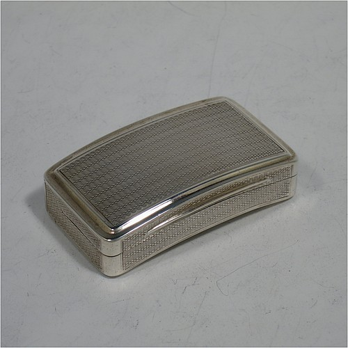 A very handsome Antique Georgian Sterling Silver snuff box, having a rectangular body which is also curved to fit the pocket, decorated with engine turning and hand-chased reeded borders, an applied thumb-piece, and with a gold gilt interior. The dimensions of this fine hand-made antique silver snuff box are length 7cm (2.75 inches), width 4.5 cms (1.75 inches), depth 2.3 cms (0.8 inches), and it weighs approx. 77g (2.5 troy ounces).