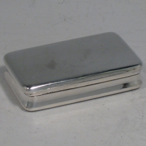 Antique Georgian sterling silver snuff box, having a very plain body, with gold-gilt interior, and hinged lid. Made by Alexander J. Strahan of London in 1804. Length 7.5 cms (3 inches), width 4.5 cms (1.75 inches). Weight approx. 58g (1.9 troy ounces).
