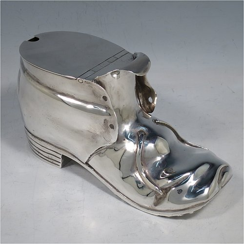 An Antique Victorian Silver Plated spoon warmer, in the shape of a leather shoe, having a hand-chased body with invisibly hinged lid opening, and all sitting on a hobnail boot base with heel. Made by Thomas Latham & Ernest Morton of Birmingham in ca. 1880. The dimensions of this fine hand-made silver-plated spoon warmer are length 16.5 cms (6.5 inches), height 9.5 cms (3.75 inches), and width 7 cms (2.75 inches).