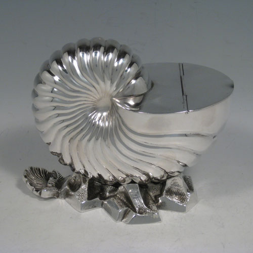 Antique Victorian silver plated spoon warmer, in the shape of a Nautilus shell, having a hinged lid, and cast rock base with shell thumb-piece. Made by Elkington and Co., with a manufacturing date letter for 1879. Length 15 cms (6 inches), height 13 cms (5.25 inches).