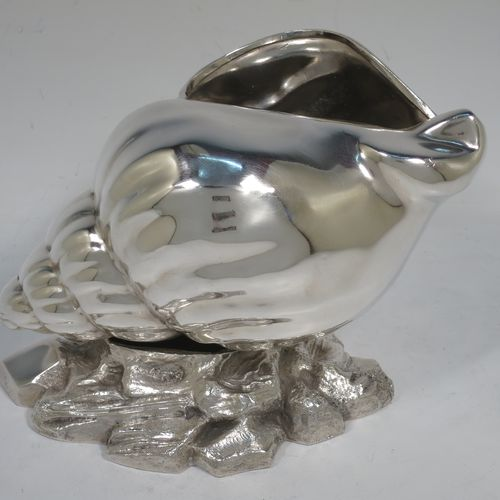 A handsome Antique Victorian Silver Plated spoon warmer, in the shape of a Conch shell, having a hand-chased body, and all sitting on a cast rock base with shells. Made in ca. 1880. The dimensions of this fine hand-made antique silver-plated spoon warmer are length 18 cms (7 inches), height 12 cms (4.75 inches), and width 10 cms (4 inches).