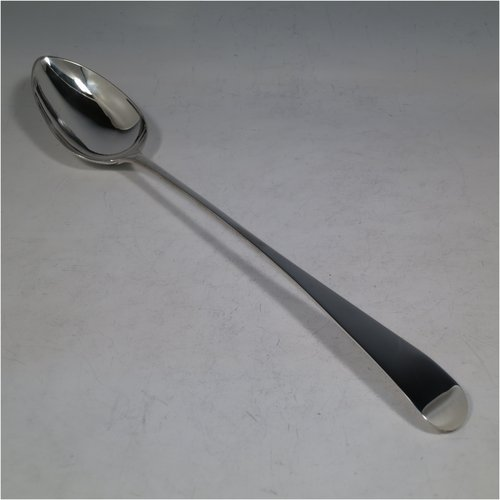 An Antique Scottish Georgian Sterling Silver Old English pattern stuffing spoon, having a very plain handle with pip on reverse, and a plain oval bowl. Made by James McKay of Edinburgh in 1807. The dimensions of this fine hand-made antique silver stuffing spoon are length 33 cms (13 inches), and it weighs approx. 125g (4 troy ounces).