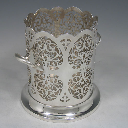Sterling silver pierced siphon stand made in Birmingham, 1932. Height 15 cms, internal diameter 11 cms.