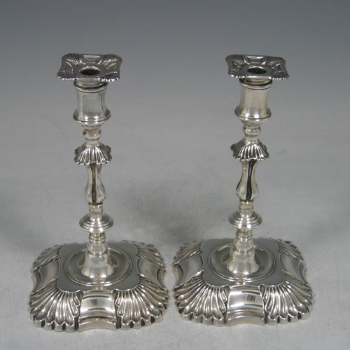 Antique Victorian sterling silver pair of tapersticks made by Thomas Bradbury of London in 1898. Height 14 cms.