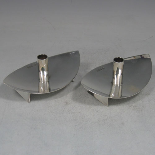 Pair of sterling silver 'Modernistic' tapersticks made by Cooper Brothers & Sons Ltd., of Sheffield in 1965. Length 12 cms, width 8 cms. Weight 6.5 troy ounces.