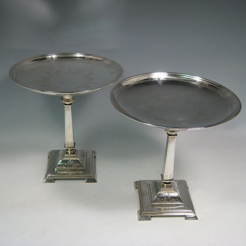 Antique Victorian sterling silver pair of tazzas, having round removable dishes, square-section tapering columns, and square pedestal feet, all hand-engraved with greek key and floral work. Made by Henry Wilkinson of Birmingham in 1870. Diameter of dishes21 cms (8.25 inches), height 21.5 cms (8.5 inches). Total weight approx. 1,277g (41.2 troy ounces).