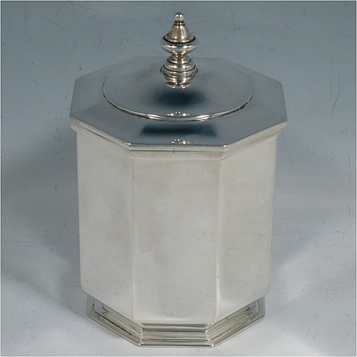 An Antique Edwardian Sterling Silver tea caddy box, having a plain straight-sided octagonal body, a hinged lid with cast urn-shape finial, and all sitting on a collet foot. Made by Elkington & Co., of London in 1908. The dimensions of this fine hand-made antique silver tea caddy box are height 13 cms (5 inches), width 9 cms (3.5 inches), and it weighs approx. 312g (10 troy ounces).