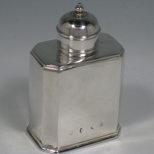Antique Georgian Britannia standard silver tea caddy box, having a straight-sided octagonal body with readed edges, and a round pull-off lid with finial (that doubled as a measure). Made in the George I period by Gundry Roode (possibbly) and hallmarked for London in 1715. The dimensions of this fine hand-made silver tea caddy box are height 12 cms (4.75 inches), length 8 cms (3 inches), width 5.5 cms (2.25 inches), and it weighs approx. 175g (5.6 troy ounces).