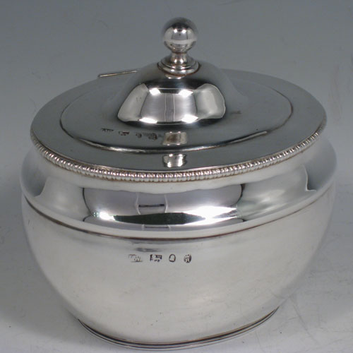 Antique Georgian sterling silver plain oval tea caddy box with gadroon edge and ball finial. Made by John Watson of Sheffield in 1813. Height 12 cms (4.75 inches), length 11.5 cms (4.5 inches), width 9 cms (3.5 inches). Weight approx. 7 troy ounces (217g).
