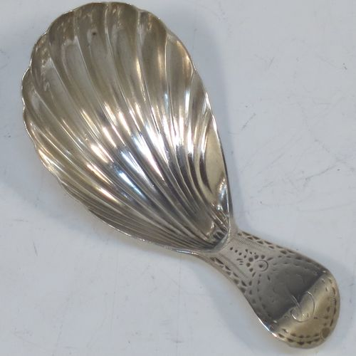 A very elegant Antique Georgian Sterling Silver tea caddy spoon, having an engraved curved handle, and a hand-chased shell style oval bowl. Made in London in 1788. The dimensions of this fine hand-made antique silver tea caddy spoon are length 7 cms (2.75 inches), width 3.5 cms (1.3 inches), and it weighs approx. 11g (0.4 troy ounces). Please note that this item is monogrammed.