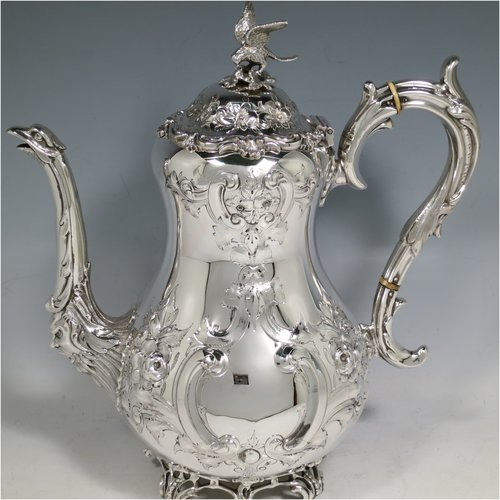An Antique Victorian Sterling Silver four-piece tea and coffee set, having round baluster bodies  with hand-chased floral decoration, with silver insulated handles, cast eagle finials, eagle face spouts, the sugar bowl and cream jug with gold-gilt interiors, and all sitting on cast and hand-pierced feet. All made by Martin & Hall, with the teapot & cream jug from London in 1870, the coffee pot from Sheffield in 1890, and the sugar bowl from Sheffield in 1896. The dimensions of this fine hand-made silver tea and coffee service are length of teapot 27 cms (10.6 inches), height of coffee pot 26 cms (10.25 inches), and the total weight is approx. 2,253g (73 troy ounces).