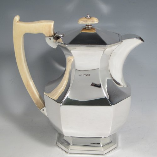 Sterling silver Art Deco tea and coffee service, consisting of Teapot, Coffee pot, sugar bowl, cream jug, and tea tray. Having plain octagonal bodies, with bone handles and finials, and sitting on pedestal feet, displayed on an original octagonal tea tray with matching handles. All made by Emile Viner of Sheffield in 1938. The dimensions of this fine hand-made silver tea and coffee service are length of tray 53.5 cms (21 inches), width 12.75 inches (32.5 cms), height of coffee pot 20 cms (8 inches), and with a total weight of approx. 3,500g (113 troy ounces).