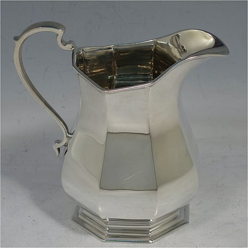 A Sterling Silver Art Deco style four-piece tea and coffee service, having plain octagonal panelled and bellied bodies, with black wooden handles and cast finials, domed lids with hinges, and sitting on hexagonal pedestal feet. Made by Roberts & Belk Sheffield in 1930. The dimensions of this fine hand-made tea and coffee service are length of teapot 24 cms (9.5 inches), height of coffee pot 23 cms (9 inches), and the total weight is approx. 1,925g (62 troy ounces).