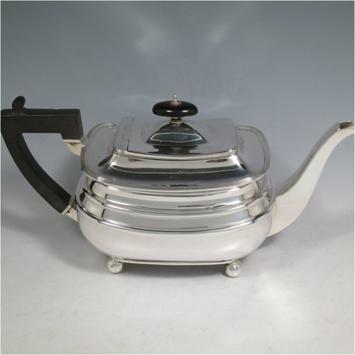 A Sterling Silver four-piece tea and coffee set, having plain rectangular baluster bodies with rounded corners and reeded borders, with wooden handles and finials, and all sitting on four ball feet. Made by James Dixon & Sons of Sheffield in 1927. The dimensions of this fine hand-made silver tea and coffee service are length of teapot 29 cms (11.5 inches), height of coffee pot pot 24 cms (9.5 inches), and the total weight is approx. 1,842g (59 troy ounces).