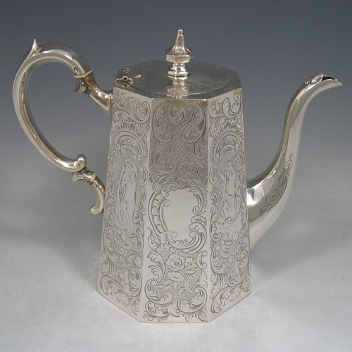 Antique Victorian sterling silver four-piece tea and coffee service, consisting of a coffee pot, tea pot, sugar bowl, and cream jug, having octagonal panelled bodies with hand-engraved floral decoration, hinged lids with finials, and insulated silver handles. Made by Hayne and Cater of London in 1848. Height of coffee pot 22 cms (8.75 inches), length of teapot 23 cms (9 inches). Total weight approx. 1,967g (63.5 troy ounces).