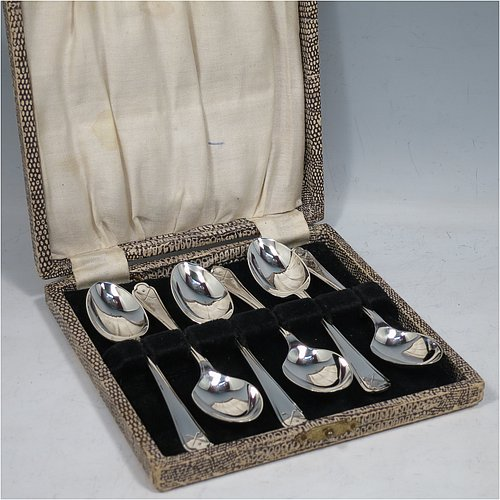 A Sterling Silver set of six tea or coffee spoons, having plain oval bowls, handles with reeded borders, and having crossed golf clubs and ball motifs on the ends, all in their original cream satin and black velvet-lined presentation box. Made by Walker & Hall of Sheffield in 1933. The dimensions of this fine hand-made set of teaspoons or coffee spoons are length of each spoon 11 cms (4.3 inches), and the total weight is approx. 78g (2.5 troy ounces).