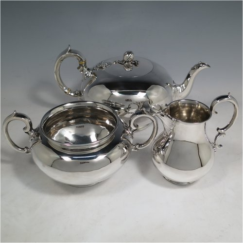 An Antique Victorian Sterling Silver three-piece  tea set, consisting of a teapot, sugar bowl and cream jug. The bodies in a plain round style with scroll handles, the teapot with silver handle and finial, and all sitting on collet feet. Made by the Barnard Brothers of London in 1847. The dimensions of this fine hand-made antique silver tea service are length of teapot 26 cms (10.25 inches), height 13.5 cms (5.25 inches), and it weighs a total of approx. 1,101g (35.5 troy ounces).