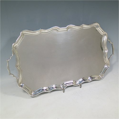 A Sterling Silver tray, having a very plain ground, with an applied Bath edged border, with two cast side-handles, and sitting on a flat base. Made by Bert Gordon of Birmingham in 1949. The dimensions of this fine hand-made silver tray are length (inc. handles) 40 cms (15.75 inches), width 22 cms (8.5 inches), and it weighs approx. 884g (28.5 troy ounces).