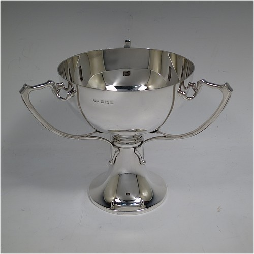 A very handsome Sterling Silver Art Nouveau three-handled trophy cup, having a plain round body, with three handles, and sitting on a pedestal foot. Made by the Adie Brothers of Birmingham in 1922. The dimensions of this fine hand-made sterling silver Art Nouveau trophy cup are height 17 cms (6.5 inches), diameter of main body 15 cms (6 inches), and it weighs approx. 765g (22.7 troy ounces).