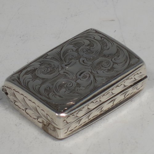 An Antique Victorian Sterling silver vinaigrette, having hand-engraved floral decoration, reeded sides, a gold-gilt interior, and a hand-pierced grill with floral work. Made by Joseph Taylor of Birmingham in 1843. The dimensions of this fine hand-made silver vinaigrette are length 2.5 cms (1 inch), width 2 cm (0.6 inches), and depth 0.8 cm (0.3 inches).