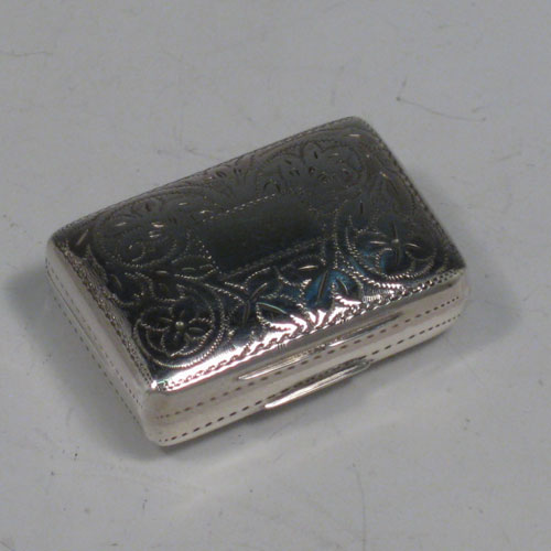 Antique Georgian sterling silver vinaigrette, having a rectangular body with hand-engraved floral decoration and a vacant cartouche, a hinged lid, a gold-gilt interior with hinged hand-chased grill. Made by Francis Clark, of Birmingham in 1834. The dimensions of this fine hand-made silver vinaigrette are length 3 cms (1.25 inches), and width 2 cms (0.75 inches).
