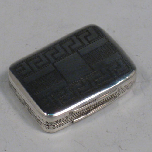 Antique Georgian sterling silver vinaigrette, having a rectangular body with hand-engraved Greek-Key decoration, a hinged lid, and a gold-gilt interior with hinged fillagree grill. Made by Samuel Pemberton of Birmingham in 1805. The dimensions of this fine hand-made silver vinaigrette are length 2.5 cms (1 inches), and width 2 cms (0.75 inches).