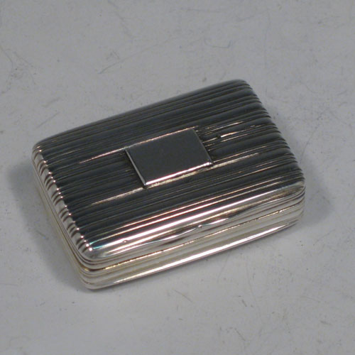 Antique Georgian sterling silver vinaigrette, having a rectangular body with hand-engraved reeded decoration and vacant cartouche, a hinged lid, a gold-gilt interior with hinged hand-pierced and chased grill with floral decoration. Made by Nathaniel Mills of Birmingham in 1828. The dimensions of this fine hand-made silver vinaigrette are length 4 cms (1.5 inches), and width 2.5 cms (1 inch).